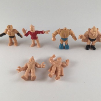 Counterfeit Lot of Eight Figures