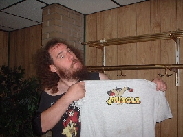 Necro Butcher, a professional wrestler, showing off his M.U.S.C.L.E. T-Shirt